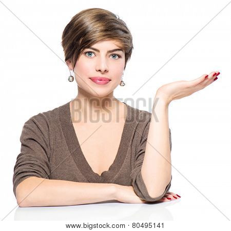 Young beauty casual woman showing empty copy space on the open hand palm on white background. Girl presenting point by raised hand for text. Gesture for selling product, advertisement. Presentation