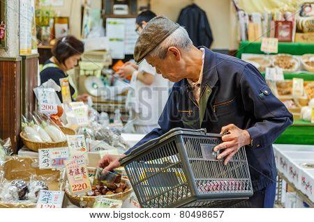 Shop Kepper at Nishiki Market in Kyoto