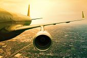passenger jet plane flyin above cloud scape use for aircraft transportation and traveling business background poster