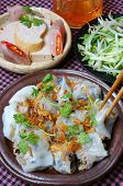 Vietnamese food Banh Cuon name Rice noodle roll or rolled cake is made from rice batter filled with mushroom pork served with Vietnam pork sausage sliced cucumber bean sprouts and sauce poster