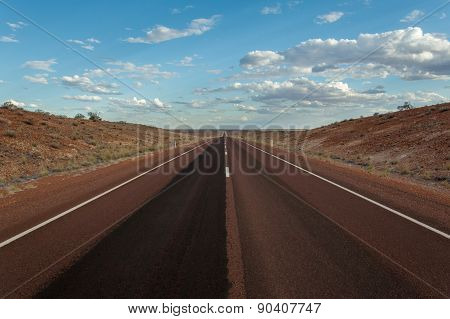 An endless straight road trough the outback in Australia. poster