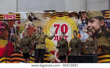 Donetsk - May, 9, 2015: Artists Sing Wartime Songs At A Concert In Honor Of The Victory In World War