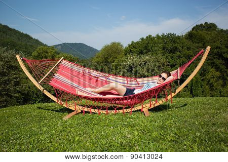 Young Female Relaxing In A Hammock