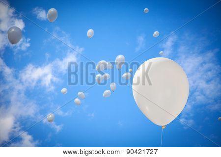 White Balloons On Sky Background