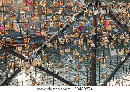 PARIS, FRANCE - NOVEMBER 01, 2014: Locks on the railing of a bridge in Paris