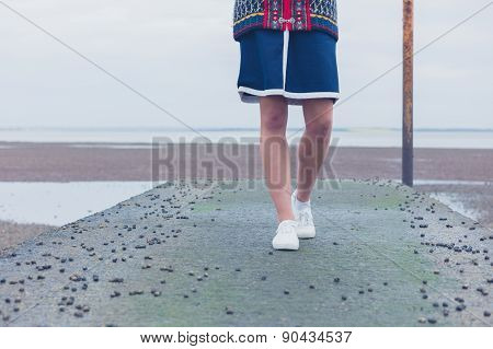 Woman Walking On Pier With Whelks