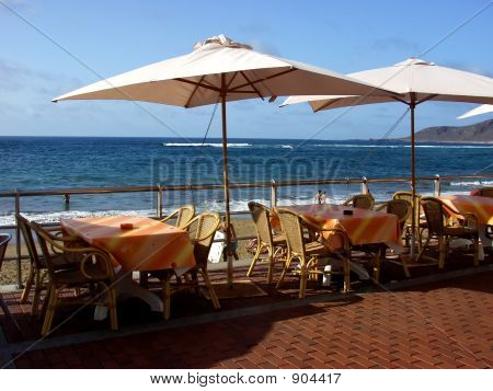 restaurant outdoor furniture in the beach whit blue sky background poster