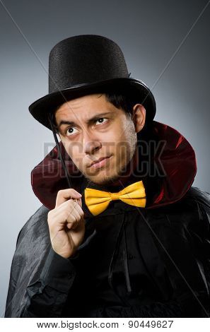 Funny magician man with wand and hat poster