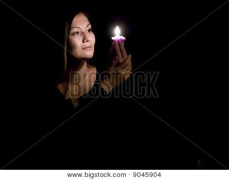 Portrait Of Yoing Woman With Candle