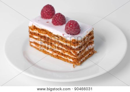 Piece of cake with a raspberry