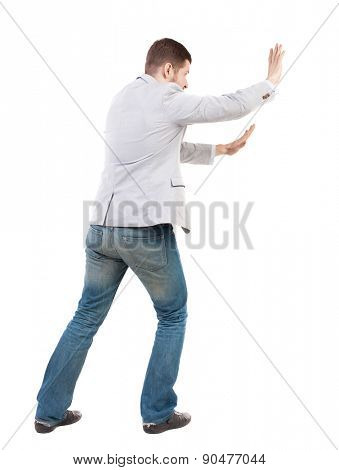 back view of business man pushes wall. Isolated over white background. Rear view people collection. backside view of person.  Bearded man ran into an obstacle.
