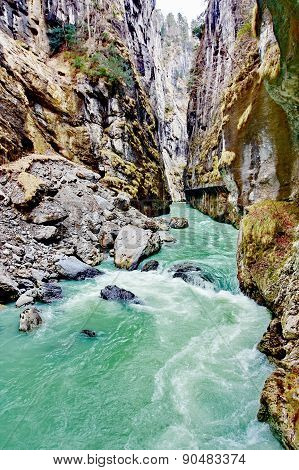 Aare Gorge - Aareschlucht a section of the river Aare that carves through a limestone ridge near the town of Meiringen in the Bernese Oberland region of Switzerland. poster