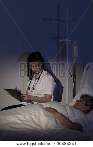 Doctor caring about terminally ill patient at night poster