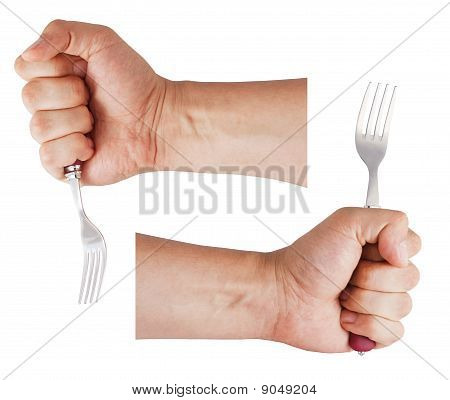 Man's Hand Holds A Fork