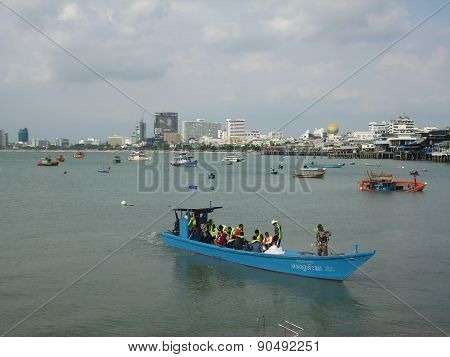 blue boat with people on Board, cast adrift from the shore