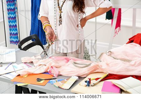 Female Fashion Designer Holding Big Golden Tailor Scissors In Hand