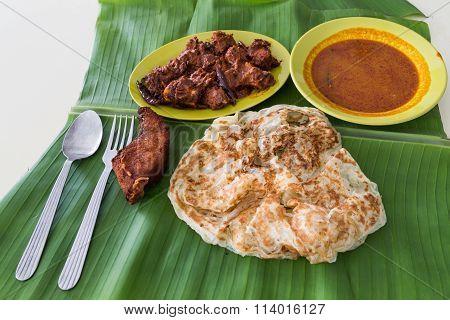 Roti Prata On Banana Leaf With Masala Mutton, Fish, Curry
