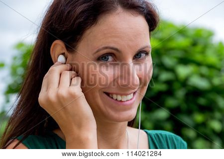 woman listens to music on mobile phone