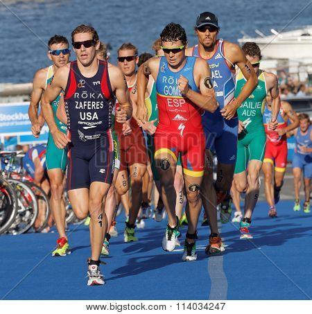 STOCKHOLM SWEDEN - AUG 23 2015: Close-up of group of running triathletes including the leader Javier Gomez wearing sun glasses in the Men's ITU World Triathlon series event August 23 2015 in Stockholm Sweden
