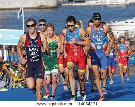 Close-up Of Group Of Running Triathletes Including The Leader Javier Gomez