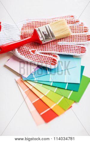 paintbrush, gloves and pantone samplers