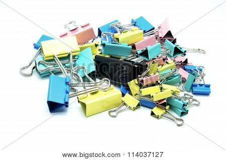Various size and colorful paper clips. Selective focus on black at center