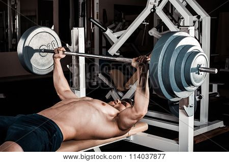 Muscular Man Doing Heavy Exercise.