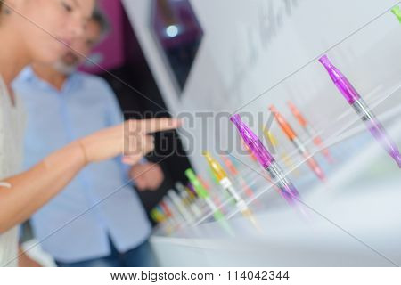 Couple looking at different colored vaporizers