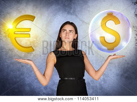 Woman holding dollar sign in bubble and euro