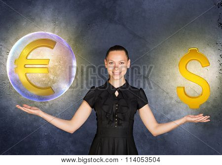 Woman holding euro sign in bubble and dollar