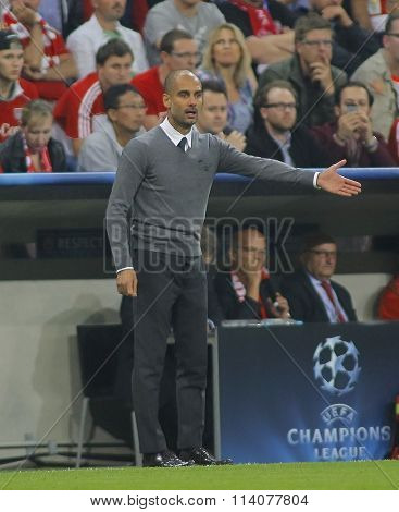 MUNICH, GERMANY - SEPTEMBER 17 2014: Pep Guardiola gestures guring the UEFA Champions League match between Bayern Munich and Manchester City, at the Allianz Arena, Munich, Germany.