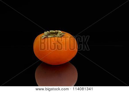 Persimmon against a black background