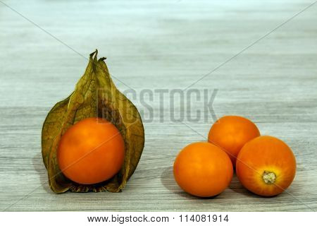 Cape gooseberries on a wooden board