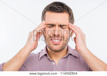 Attractive Man Suffering Of Headache