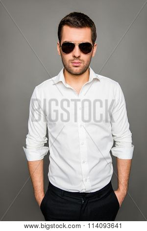Portrait Of Serious Young Man I N Spectacles Holdind Hands In Pockets