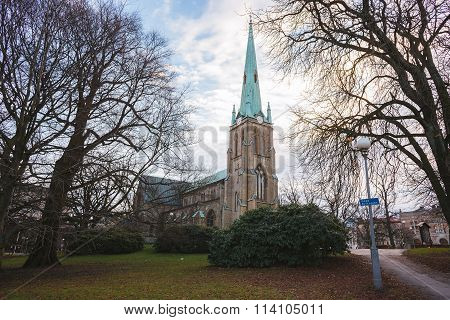 Church in Gothenburg and beautiful park. Winter sunny day, Sweden