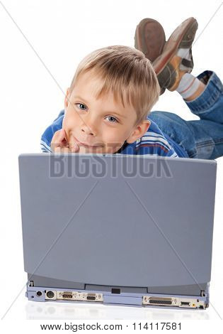 Smiley Five Years Old Boy with Laptop Isolated on White