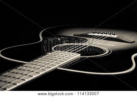 black and white image of a guitar