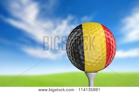 Golf ball with Belgium flag colors sitting on a tee