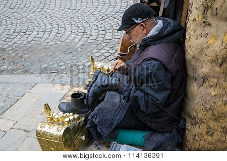 Shoe shiner in Kosovo