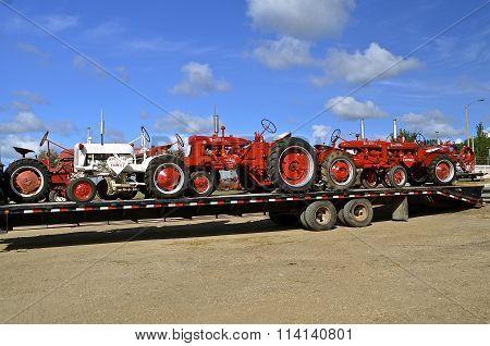 Farmall tractors arrive at a farm show