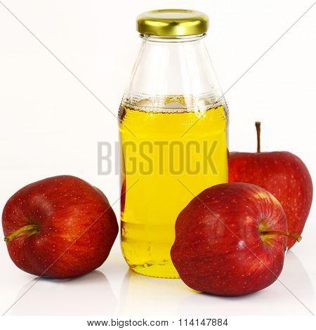 Fresh Apples And A Bottle Of Apple Cider Vinegar.