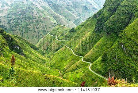 Pass road hugs the mountain plateau of Dong Van, Ha Giang, Vietnam