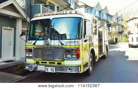 SURREY, BC, CANADA.  MARCH 16, 2015.  A fire truck from the City of Surrey on scene at a townhouse complex.