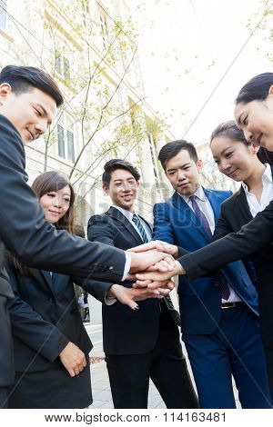 Group of business people working togther