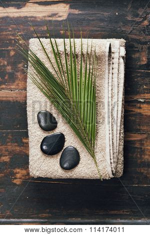 Spa background (towel, massage stones and leaf )