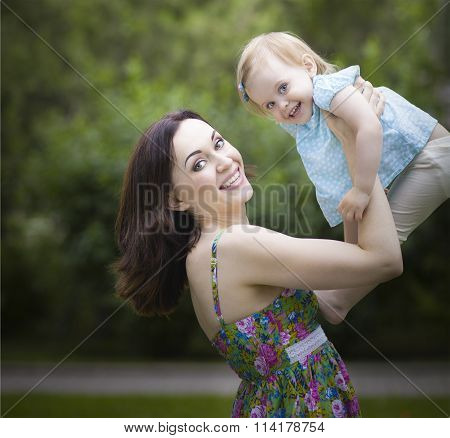 Beautiful Young Mother With Daughter In Summer Park