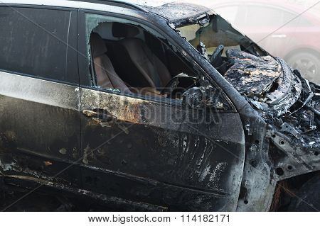 Accident Or Arson Burnt Car On The Road Closeup