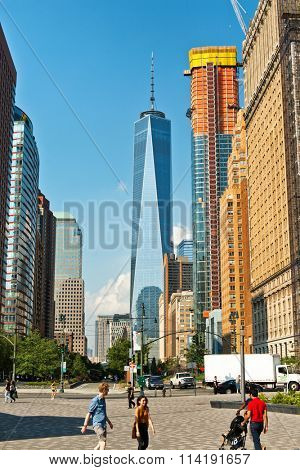 NEW YORK - AUGUST 27: View between surrounding buildings of the new One World Trade Center built at Ground Zero in New York to replace the Twin Towers. August 27, 2015 in New York.