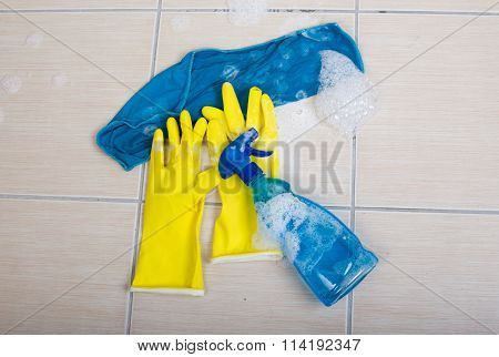 Cleaning Supplies On Tiled Floor